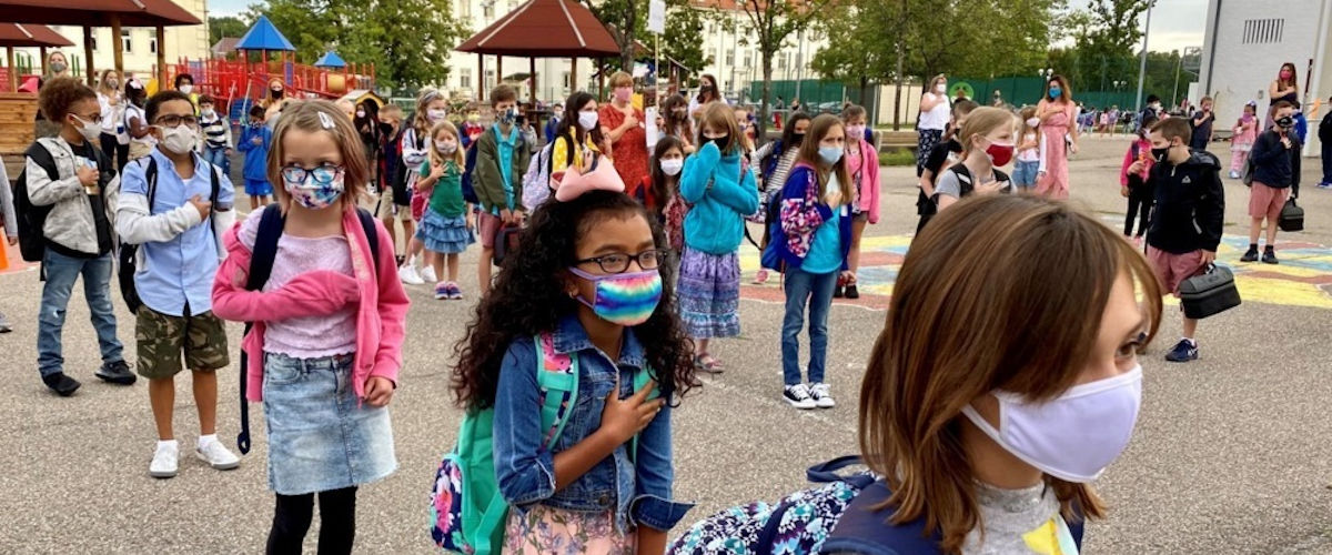 MilSpouse Money Mission Slideshow image of kids wearing masks